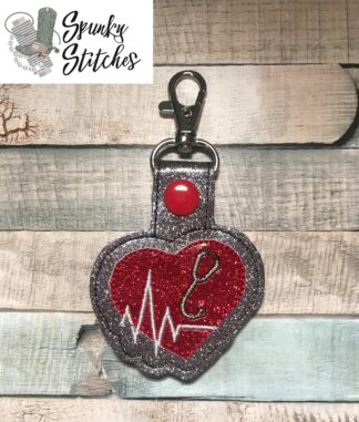 heart beat with stethescope key fob embroidery file by spunky stitches