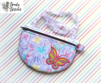 Butterfly clutch zipper bag in the hoop embroidery design by spunky stitches