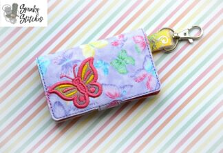 Butterfly mini wallet key fob in the hoop embroidery design by spunky stitches