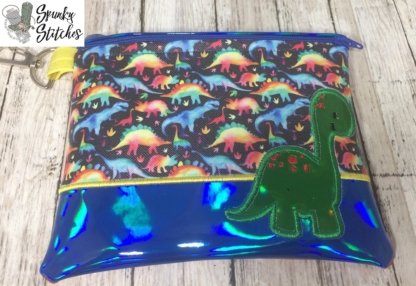 dino zipper bag in the hoop embroidery design by spunky stitches