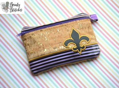 Fleur de lis zipper bag in the hoop embroidery design by spunky stitches
