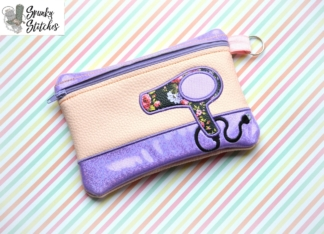 hair dryer zipper bag in the hoop embroidery design by spunky stitches