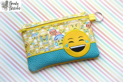 laugh out loud emoji zipper bag in the hoop embroidery design by spunky stitches