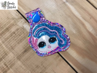 Lol Doll key fob in the hoop embroidery design by spunky stitches