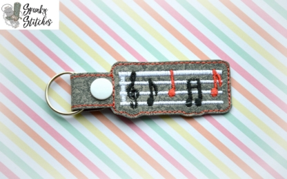 music note key fob in the hoop embroidery file by spunkystitches