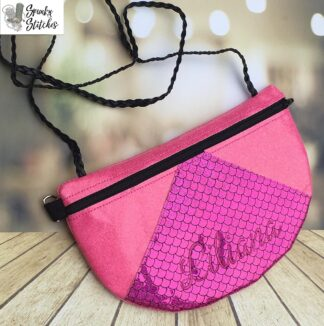 patchwork clutch zipper bag in the hoop embroidery file by spunky stitches
