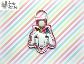 goat with flowers key fob in the hoop embroidery file by spunky stitches