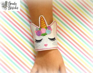 kittycorn wristlet in the hoop embroidery file by spunky stitches