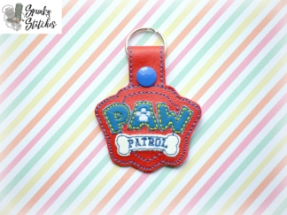 paw patrol key fob in the hoop embroidery file by spunky stitches