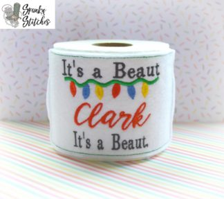 She's a beaut toilet paper wrap in the hoop embroidery file by spunky stitches