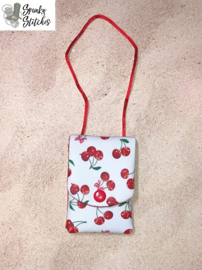 Doll flap zipper purse in the hoop embroidery file by Spunky stitches